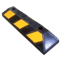 Weatherproof moulded rubber block to control position of parked vehicles.